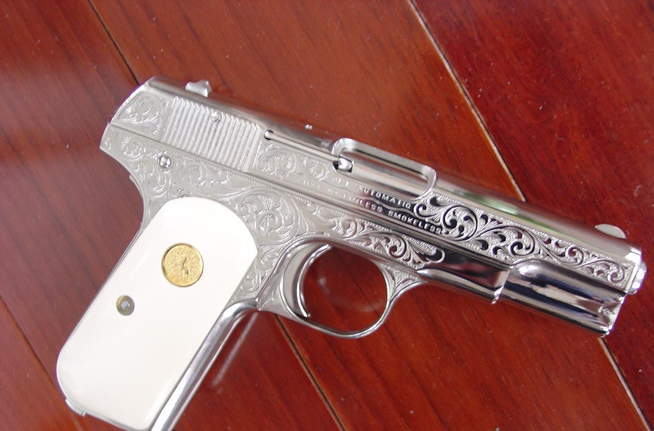 Colt 1903,32 caliber, 1915,engraved by S.Leis,refinished in bright nickel